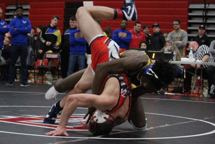Senior John Brown (back) throws his Swartz Creek opponent to the mat during the Metro League championship match at Linden Saturday, Feb. 8.