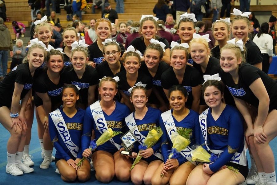 The+competitive+cheer+team+smiles+as+its+senior+night+comes+to+an+end.+The+Hornets+took+second+at+the+Kearsley+Invitational+tournament+Saturday%2C+Feb.+1.