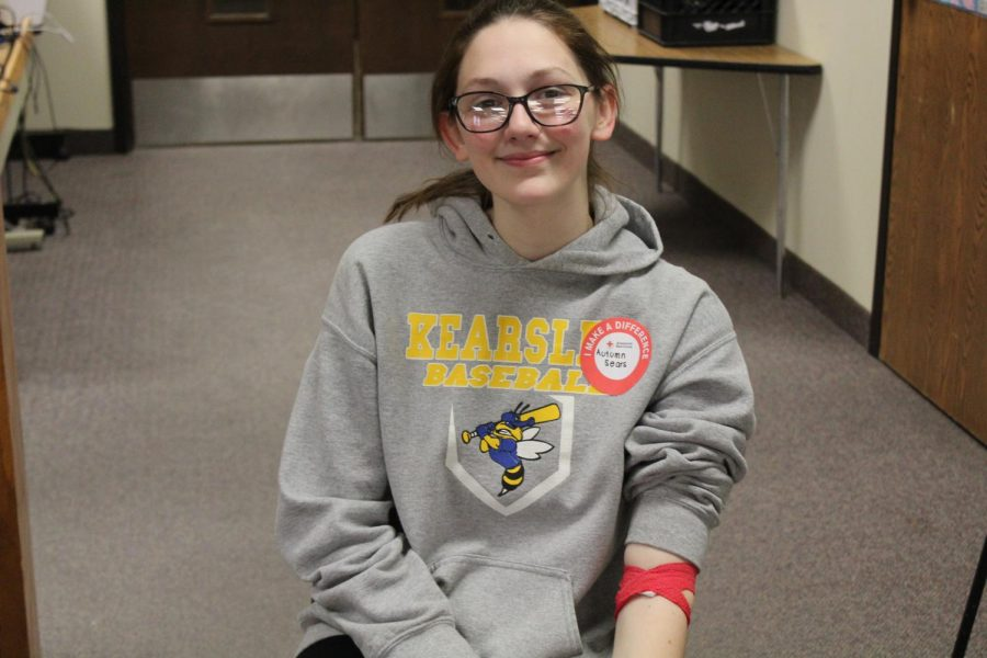 Senior Autumn Sears wears her blood drive sticker and he band-aid with pride.