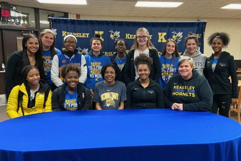 Senior MarKayla Shannon (front row, center) signed her National Letter of Intent to play basketball at Schoolcraft College Monday, March 3. Her coaches and friends supported her at the signing.