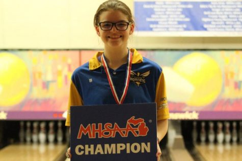 Junior Megan Timm poses after winning the MHSAA Division 2 individual state final.