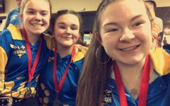Senior Jillian Locke (right) has been a member of the girls bowling program throughout high school. She enjoys the camaraderie of her teammates, including sophomore Lydia Boggs (left) and freshman Sara Ritchie (center).