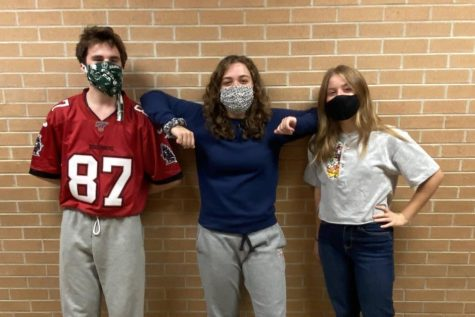 Jonathen Hart, junior (l to r), Mackenzie Atkinson, senior, and Molly Gunn, junior, return to publishing Monday, Sep. 28.