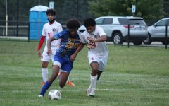 Senior Rodney Richards chases the ball down field against Swartz Creek Wednesday, Sep. 9.