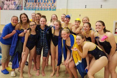Emily Gilbert breaks records for swim