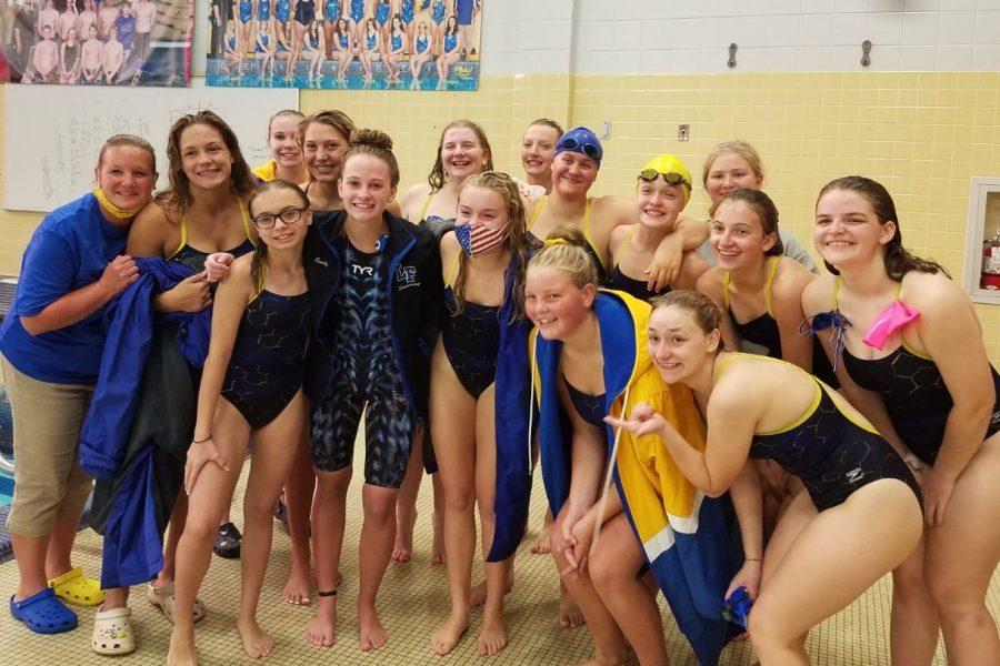 The girls swim team celebrates Emily Gilbert breaking Patti York's record Thursday, Oct. 1.