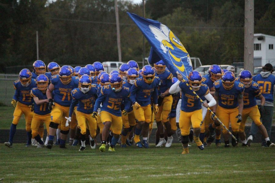 Kearsley Hornets rush the field to face off against the Holly Broncos for the Homecoming game Friday, Oct. 2.