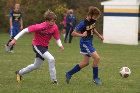 Freshmen Caden Saxton takes the ball from North Branch Thursday, Oct. 15.