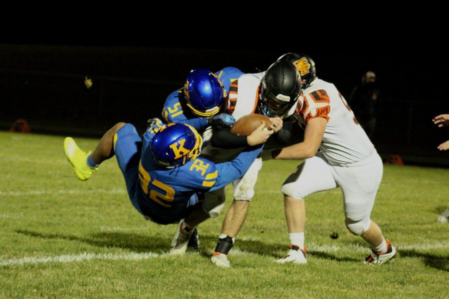Senior Isaiah Stiverson tackles the ball carrier from Flushing, Friday, Oct. 16.