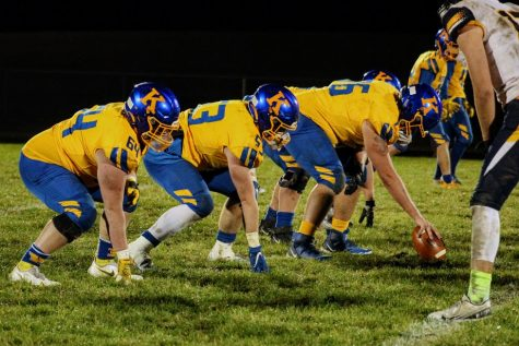 The Hornet offensive line sets up for a snap against the Goodrich Martians Friday, Oct. 23.