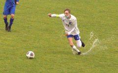 Senior Caleb Lasley chases down the ball splashing up water at Brandon Thursday, Oct. 1.