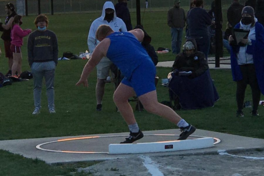 Brendan Schanick sets up to compete and throw for discus.