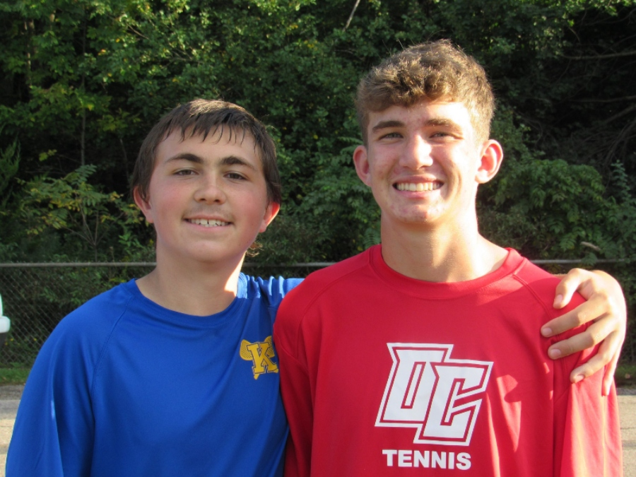 Freshmen Owen Clement and assistant coach Trenton Griffith pose for a picture after Clements match.