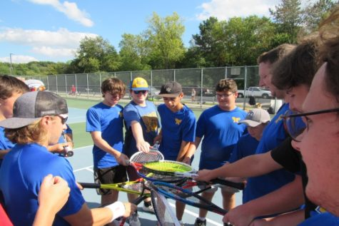 The Kearsley boys tennis team huddling up before starting their matches.