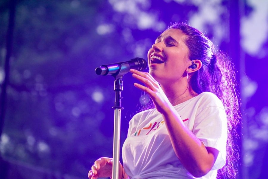 Alessia Cara deep in song while at a concert.